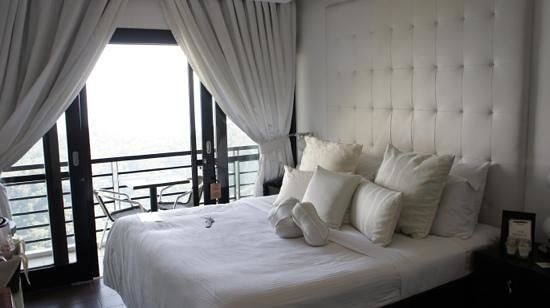 The Boutique Bed & Breakfast: Another view of the bed and balcony.