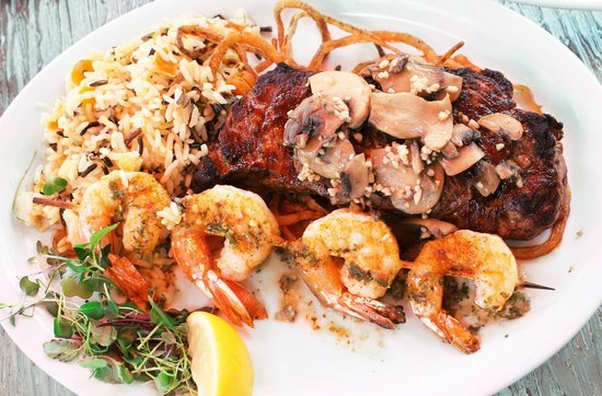 Matanzas on the Bay : New York Strip steak topped with garlic mushrooms and onions