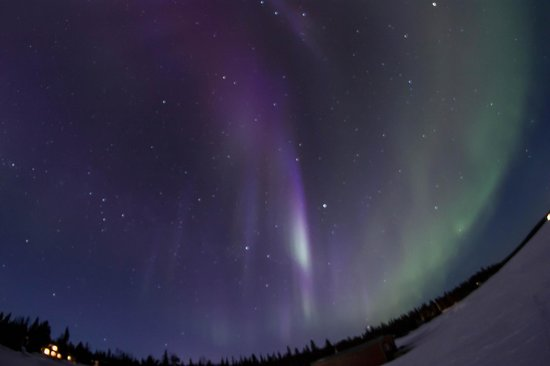 Northern Lights over Camp Alta's frozen lake