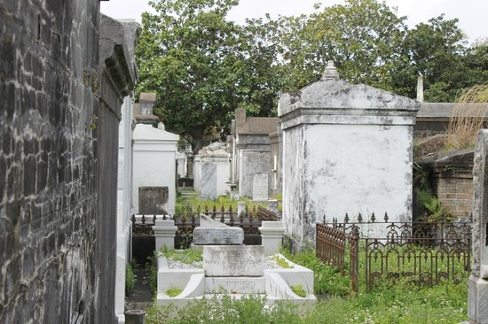 Save Our Cemeteries: Several of the tombs have elaborate cast iron gates