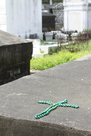 Save Our Cemeteries: Many tombs had tokens of love:  coins, toys, or Mardi Gras beads.
