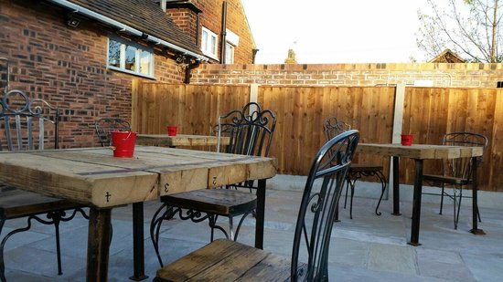 The Folks Bar and Grill: The outdoor space at the back. Big bench for 16 folks coming soon!