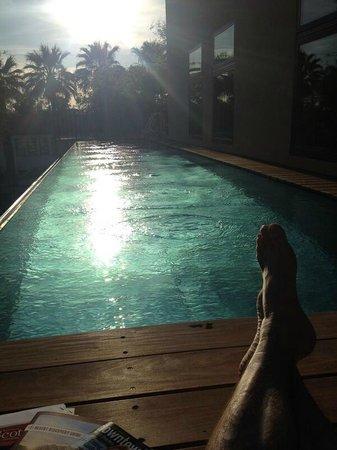 Bespoke Inn: Relax by Pool at Sunset