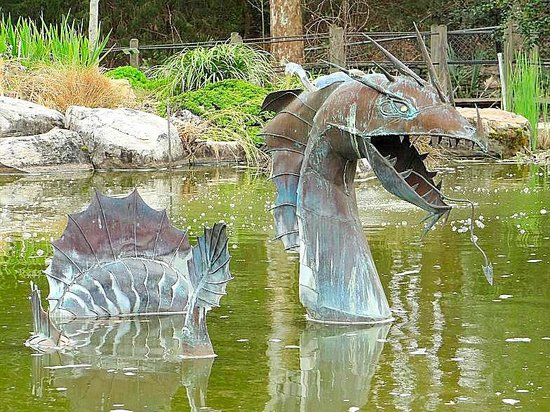 New Hanover County Arboretum: dragon sculpture in pond