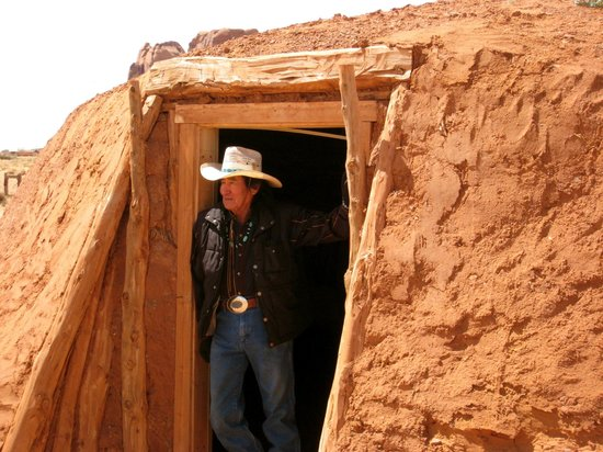 Navajo Spirit Tours - Day Tours: Don and the hogan he built at the high school