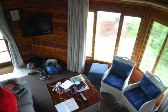 Brenton on Sea Cottages : Living room with flat screen TV