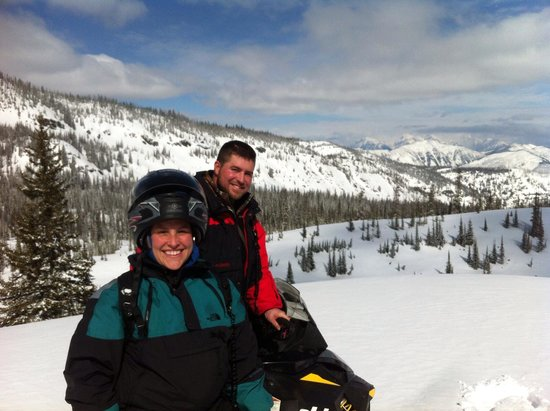 Swan Mountain Snowmobiling: My husband and I during our trip with Sean. Not just a guide but a great photographer too!