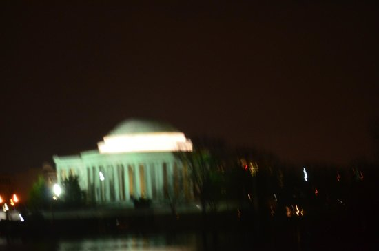 Monuments by Moonlight Night Tour: Blurred photo ( I TRIED! ) taken through plastic covered trolley window