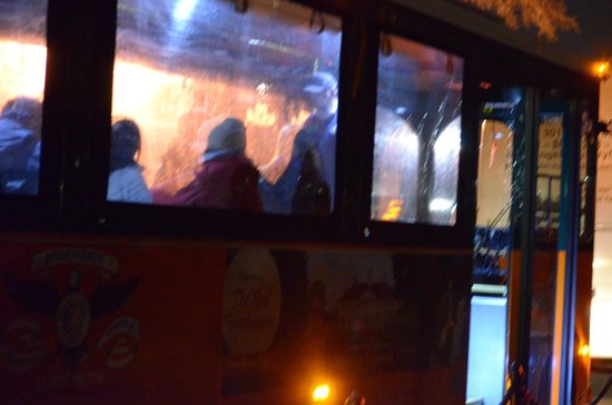 Monuments by Moonlight Night Tour: Dark night view of trolley with plastic covered windows