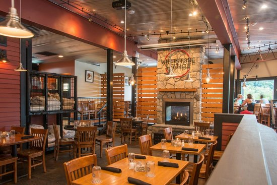 Whetstone Station Restaurant And Brewery Indoor Casual Dining Room With High Ceilings Fireplace