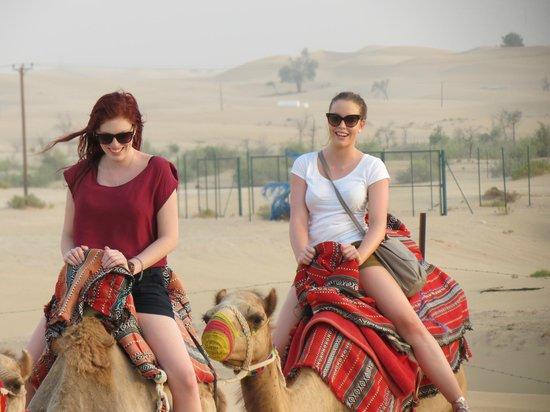 Al Badeyah Eyes Day Tours (ABET) Desert Safari: Camel Ride.