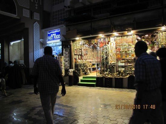 Corniche: Bejewelled Muttrah Souq at dusk.