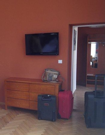 Hotel Santander : Dresser and TV, door to own hallway with bathroom