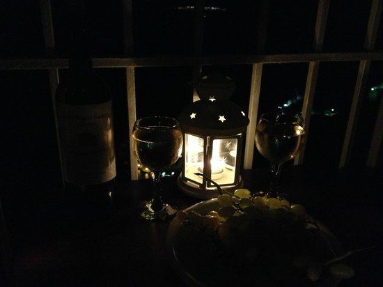 Cori Rigas Suites Wine on Our Balcony at night