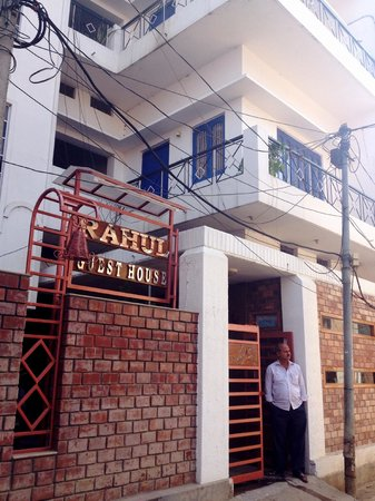 Rahul Guest House: The front view of the guesthouse with the owner standing by