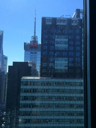 DoubleTree Suites by Hilton Hotel New York City - Times Square : H&M building directly across from the master bedroom on 43rd floor. Window is dirty.