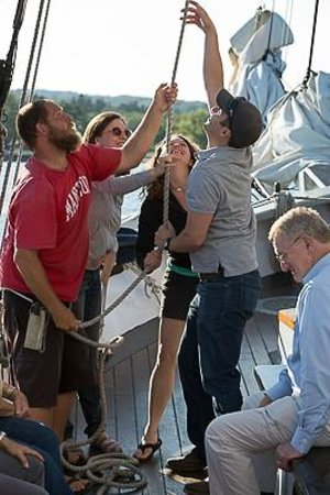 Tall Ship Manitou - Day Tours: Crew and passengers raising the foresail.