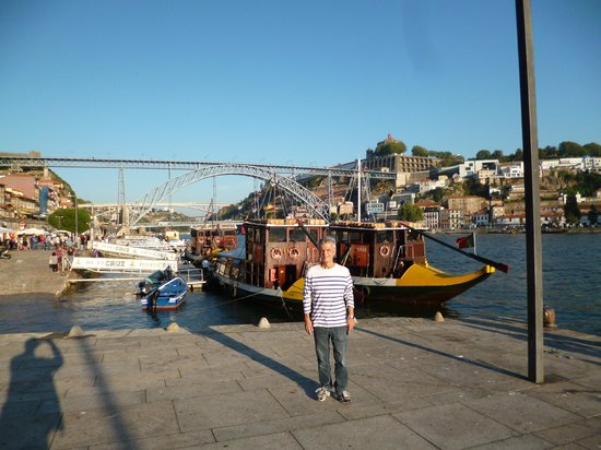 "Zona Ribeirinha : Famous D. Luís Bridge and a ""rabelo"" boat in the waters of the Douro River in O Porto"