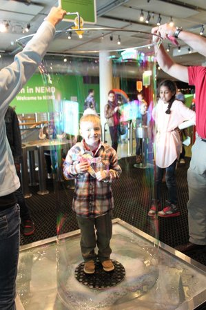 NEMO Science Museum : Standing inside a bubble with his Flat Stanley