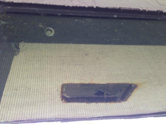 Shorewood Condominiums: Broken screen in exterior soffet