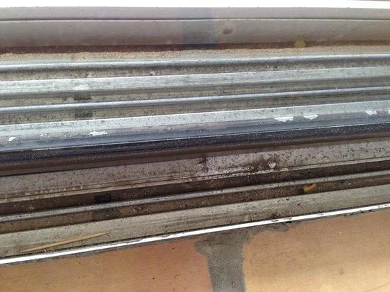 Shorewood Condominiums: Sliding glass door tracks from living room into lanai