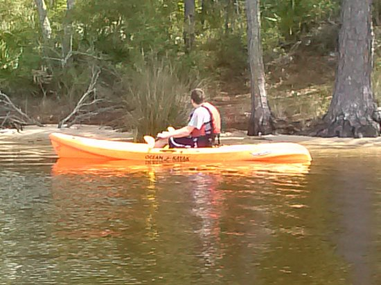 Fred Gannon Rocky Bayou State Park: My son cruising the shoreline in a rental kayak
