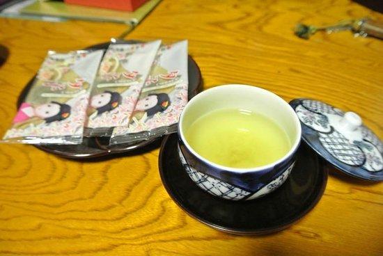 Ryokufuso: welcome drinks , hot tea and sweet.