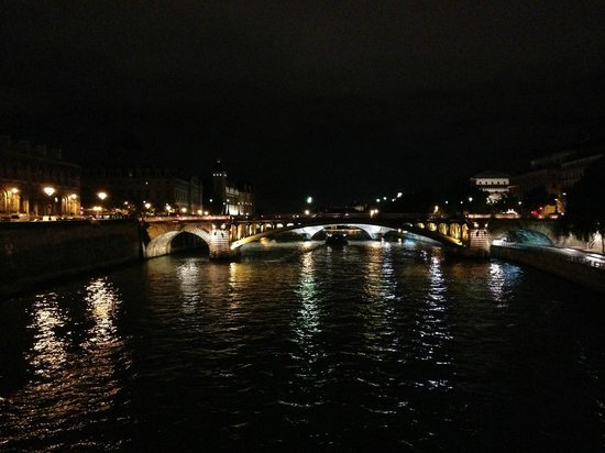 La Seine : View of Pont Notre-Dame from Pont d'Arcole - Night