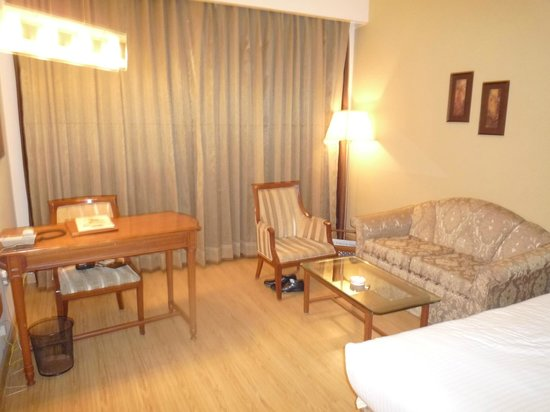 Sun-n-Sand Pune: Sitting Area Beyond the Beds