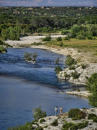 French teens braved the icy waters of the Rhone River at the Pont du Gard