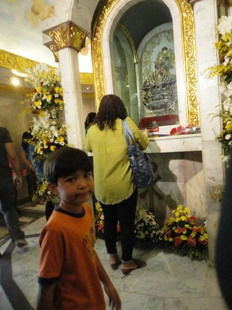 Basilica del Santo Niño: devotees offer prayers to ask for something and/or to thank God for granting their petitions