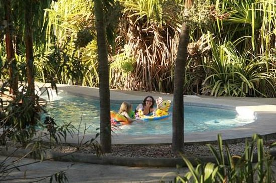 Hotel Mauna Loa: Fun in the kids' pool.  Viewed from our cabin porch.