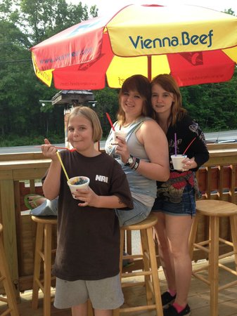 Enjoying their shave ice on the deck at Woody's Island