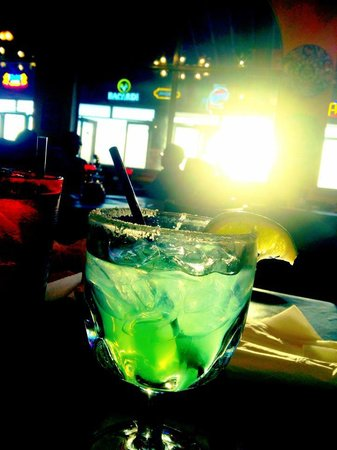 Angelina's Mexican Restaurant : St. Patrick's Day green margaritas with the sun setting in the background.