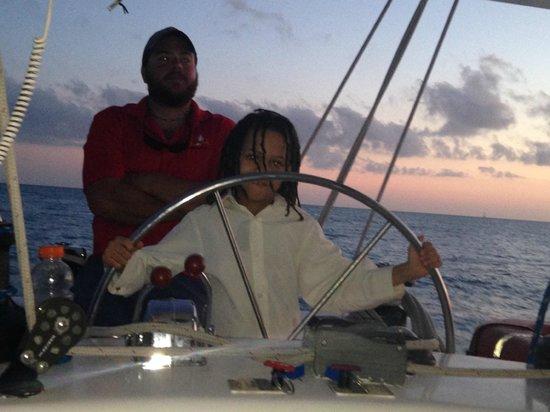 Sebago Key West: Captain John oversees Captain Kingston's cruising skills