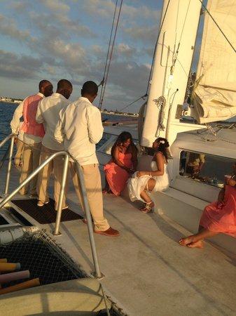 Sebago Key West: The bride, sister & groomsmen enjoying the catamaran deck at sunset