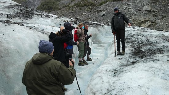 Fox Glacier Guiding: Our guide, Cole, explaining the dynamics of the glacier.