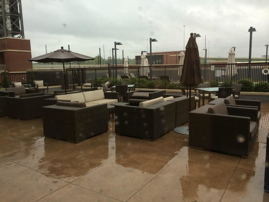 The Westin Birmingham: Outdoor seating area on 2nd floor with pool beyond