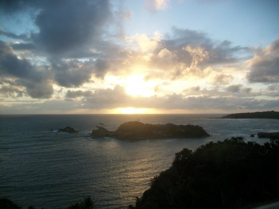 Calibishie Cove: View off balcony of penthouse at sunrise