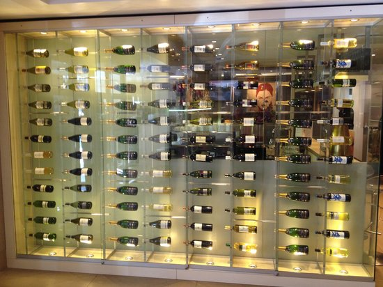 The Albus: Wine bottle wall between lobby and bar