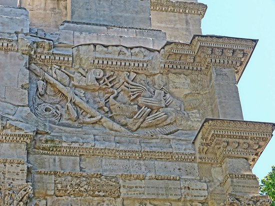 Arc de triomphe : Parts of Roman warships depicted on a frieze on the imperial arch in Orange, France.