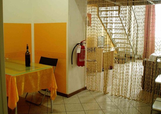 City Residence Milano: Dining area with bead curtain to sitting room