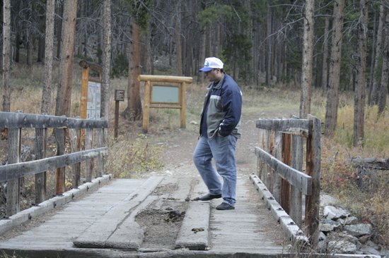 Lake Fork Trail: Cristi at the Lake Fork bridge.