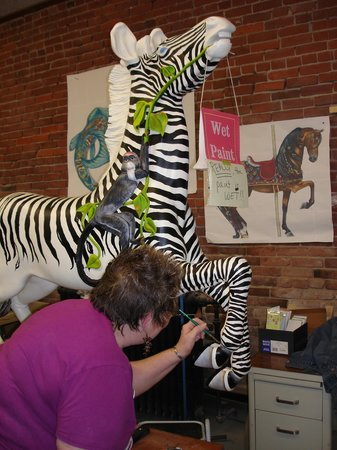 The Historic Carousel and Museum : Painting one of the animals