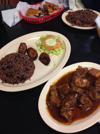 The Cuban Island Restaurant: Pork fricassee with rice and black beans, fried plantains, and salad