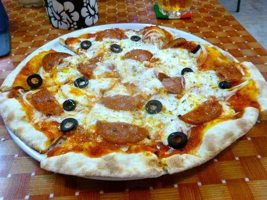 Happy Pizza : The large pepperoni, olives, and onions. Note the absence of pools of grease and the nice crust.