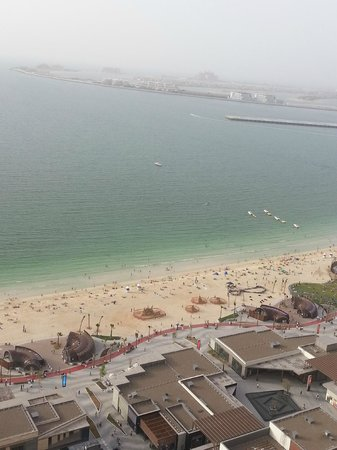 Sofitel Dubai Jumeirah Beach : View from private bar across to The Palm Jumierah Marina