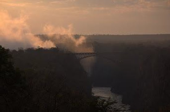 Mosi-oa-Tunya / Victoria Falls National Park: Spary at dawn fron the Victoria Falls hoetel