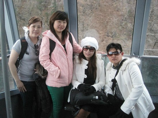 Gwongeumseong Fortress: the cable car...& that's my 2 friends...pink & grey costume