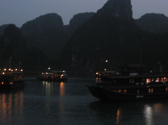 Night time in Halong Bay, lots of ships in one place.